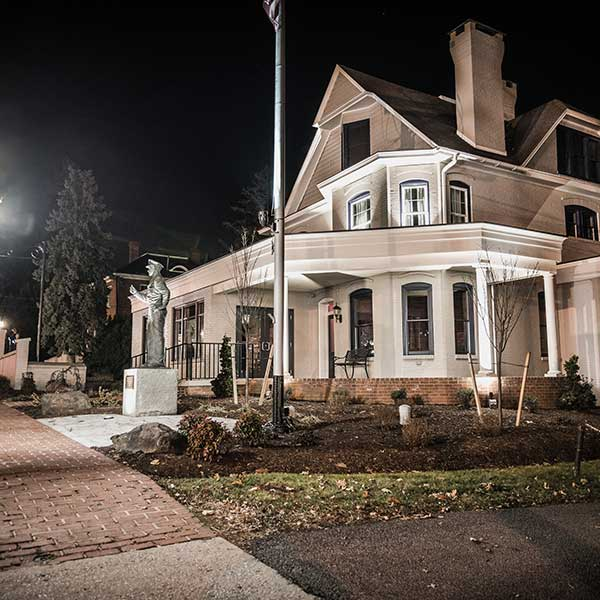 The Hall of Presidents, Gettysburg. From the exterior, at night eerily illuminated.