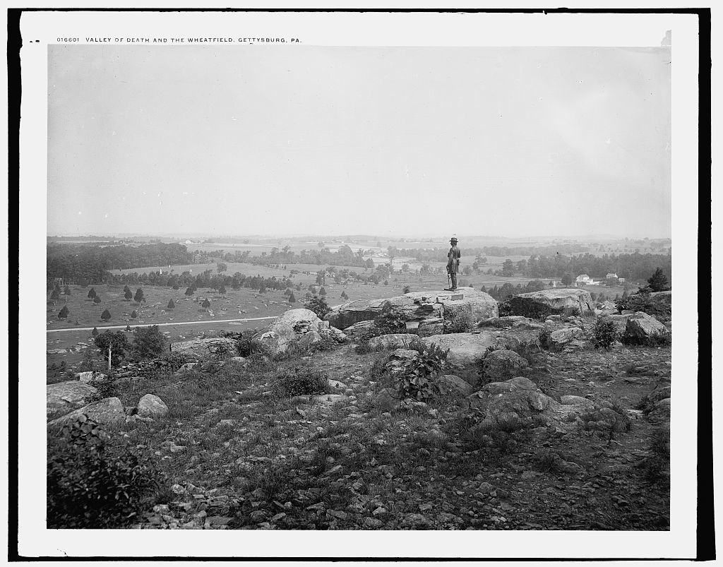 photo shows a lone soldier in black and white overlooking the gettysburg battlefield