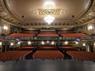 photo shows the ornate interior of the theatre with lots of color.