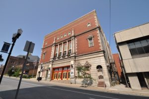 photo shows the facade of the Mishler Theater, made of red and tan brick